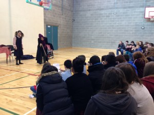 French students gather in the school hall to watch the recent French play
