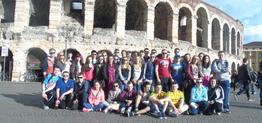 The tour group pictured outside the Roman Arena in Verona